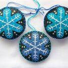 Felt snowflake ornament aqua and blue on black glitter