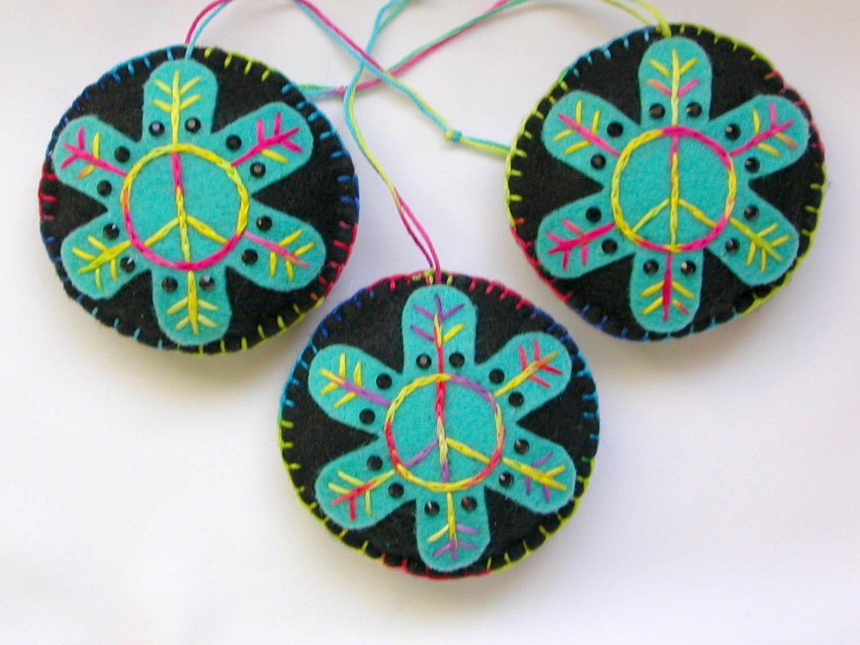 Felt peace sign snowflake ornament light aqua on black tie dye