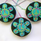 Felt peace sign snowflake ornament light aqua on black tie dye