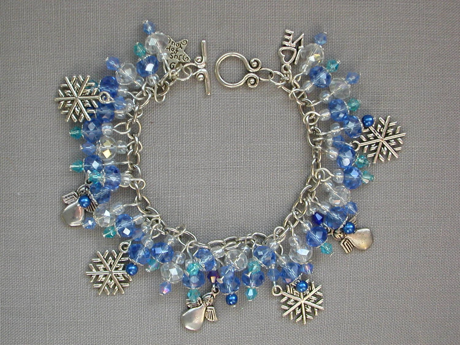 Snowflake and Angel Charm Baby Blue Crystal Bead Bracelet