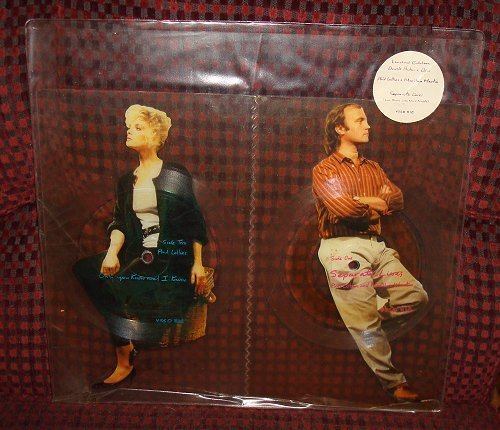 """Phil Collins Marilyn Martin Limited Ed. 7"""" Set Of Two Interlocking Shaped Picture Disc Records"""