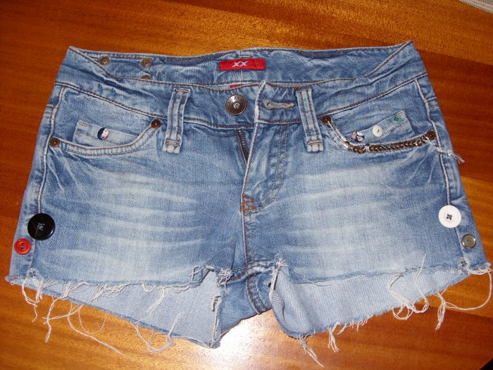 Denim shorts with buttons and sequins