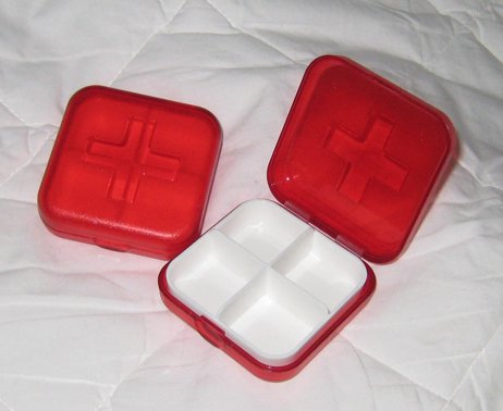 Pill vitamin box shaped like first aid kit