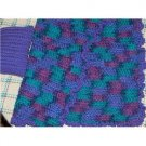 Hand crocheted Doll blanket in purples with a purple pillow