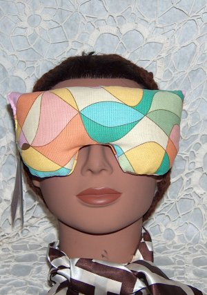 multi colored eye mask-pillow with pale pink strap