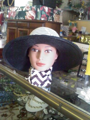 Black  and white wide-brimmed Styled by Quaker Maid vintage hat