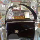 Asymetrical patent leather vintage handbag in black - large