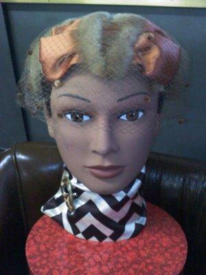 blonde mink fur over a copper colored satin covered wire base vintage hat