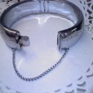 Clamper cuff style hinged silvertone vintage bracelet with safety chain - made in Hong Kong