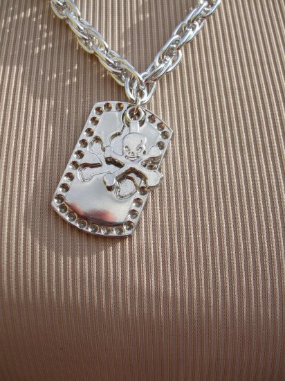 Skull and crossbones dog tag puzzle necklace