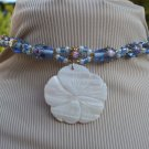 MOTHER OF PEARL CARVED FLOWER PENDANT ON LAMPWORK CHOKER