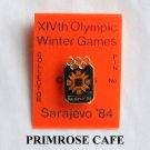 Collectors Olympics XIV 1984 Winter games Sarajevo black seal tie tac hat lapel pin