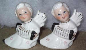 Angel figurines playing sweeze box and singing