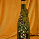Green wine bottle w/ green & blue grapes