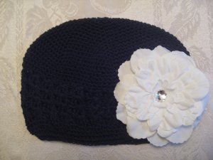 Black Kufi hat with white flower