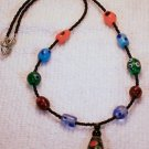 19 inch multi-color beaded necklace.  Check Our Store twodotts.ecrater.com