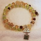 Green & Amber Color  Memory Wire Bracelet with QUILT charm.  Visit Our Store twodotts.ecrater.com