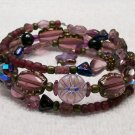 Plum iridescent beaded Memory Wire Bracelet. Visit our store twodotts.ecrater.com
