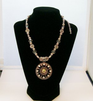 Silver  beaded necklace with pendant & rhinestone accents.