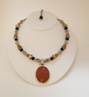 Beaded Necklace with Copper color pendant set in Sterling Silver.