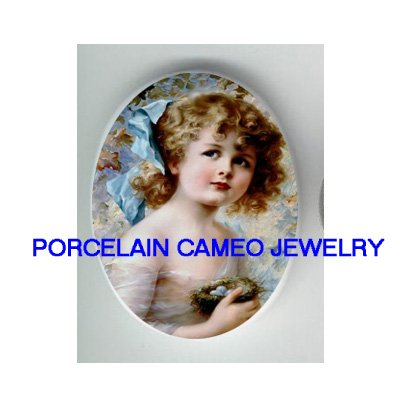 VICTORIAN BLUE RIBBON GIRL HOLDING ROBIN BIRD EGG NEST * UNSET CAMEO PORCELAIN CABOCHON