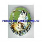 2 VICTORIAN KITTY CAT IN FORGET ME NOT BASKET* UNSET CAMEO PORCELAIN CAB