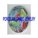 2 GREEN  PARROT MACAW BIRD TROPICAL FLOWER* UNSET PORCELAIN CAMEO CAB
