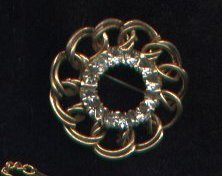 Vintage goldtone and rhinestone circle pin