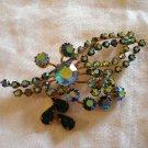 Aurora Borealis and green rhinestones floral spray pin or brooch vintage ll1067