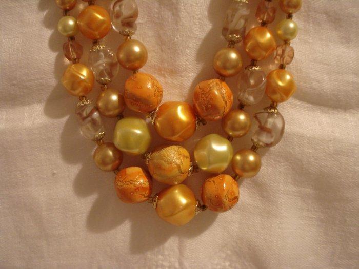 Triple strand graduated mixed plastic beads yellow orange excellent mid-century vintage ll2436