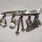JJ skis with hanging charms pin brooch as new pewter vintage ll2695