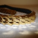 Goldtone stretch belt snake scales quilted look buckle as new preowned ll2776