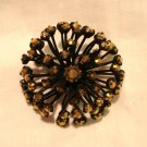 Sunburst japanned pin brooch with bronzed rhinestones preowned ll3063