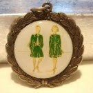 Laurel leaf pendant with plaque step dancers  vintage ll3133