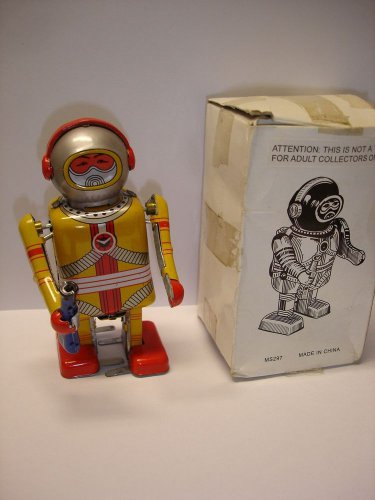 """Used & not working 4.5"""" tall Astronaut wind up tin toy robot"""
