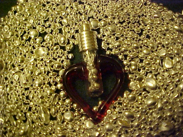 PURE SILVER BULLION ENCASED IN BLOWN GLASS RED HEART