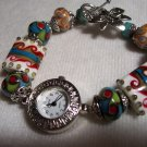 Artistic multi colored beaded wrist watch in silver tones