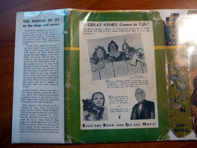 1939 MGM Wizard of Oz in original dust jacket with 8 color plates. Endpapers have stills from movie
