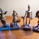Set of 4 figurines with stand