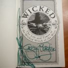 Wicked by Gregory Maguire. 1st edition, later printing.Signed and sketched by...