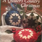 A Quilters Country Christmas by Leslie Linsley 0312036914