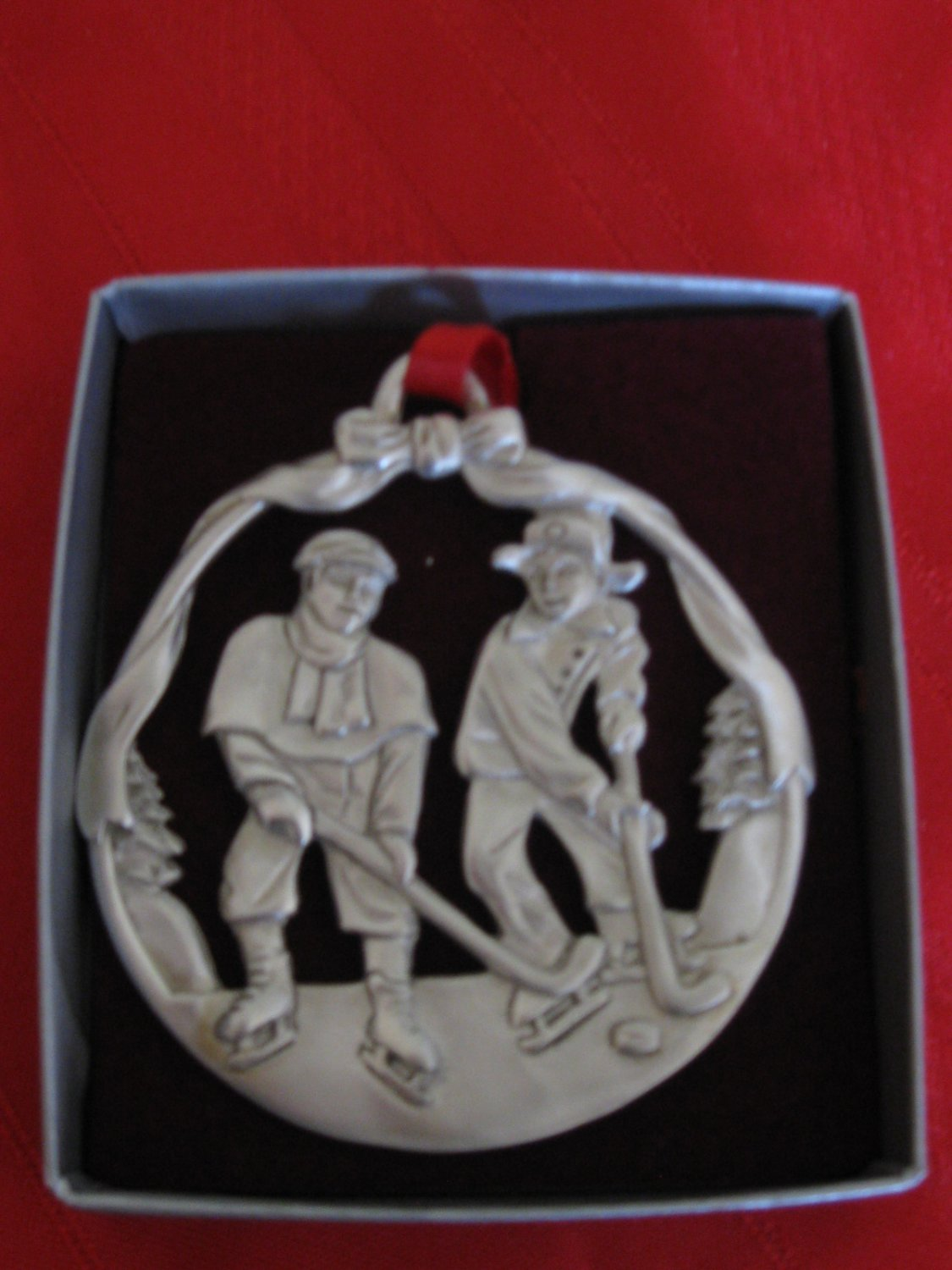 Very Nice Pewter Ornament With Children Playing Hockey by Oceanart 1998