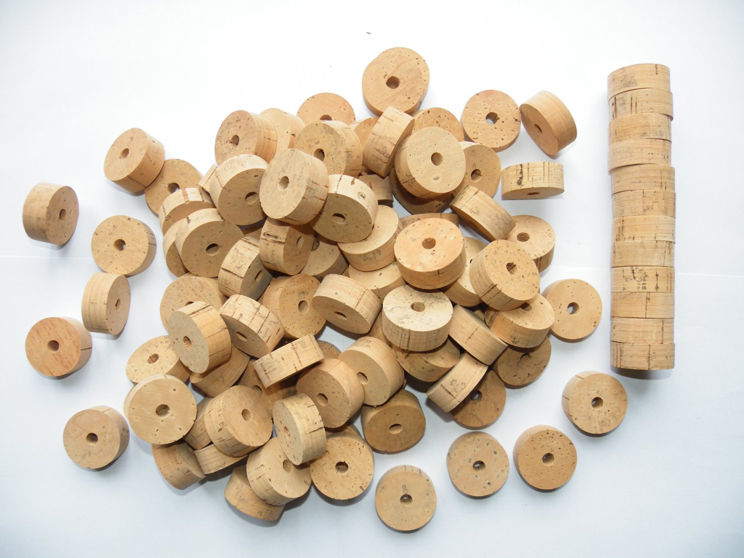 """100 CORK RINGS 11/4""""X1/2"""" BORE 1/4"""" FLOR WITH BLACK SPOTTS - 1.25"""