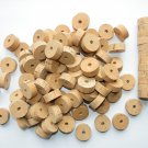 "100 CORK RINGS 11/4""X1/2"" BORE 1/4"" FLOR WITH BLACK SPOTTS - 1.25"
