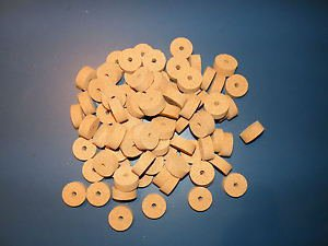 "100 AGGLOMERATED  CORK RINGS 11/4""X1/2"" FINE GRAIN  BORE 1/4"""