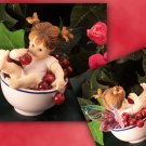 Kitchen Fairy in Bowl of Cherries