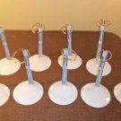 9 High Quality Doll Stands for Dolls 20-26 14-18 Inches Tall all in like new condition.