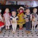 Lot of 7 Porcelain Franklin Mint Heirloom Dolls