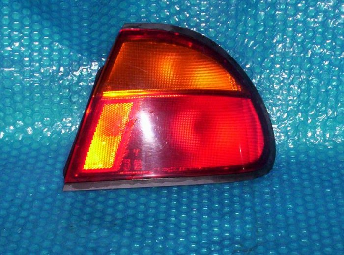 mazda  protege tail light RH  1995      stk#(702)
