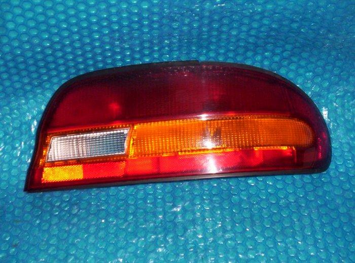 Nissan Altima 1993, 1994 Tail Light OEM#: B65502B100; RH stk#(1217)